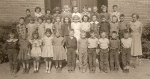 Ms. Parker's 2nd grade class (1954-55) at the Hurst School.  If you look and think real hard, you might be able to visu