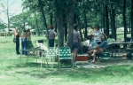 (034) 1975 Reunion Picnic Event:  Joy Bolman holding her leg, Gail Mackey pointing to something or someone, Gail Ince lo