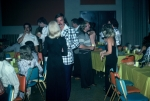 (001) 1975 Reunion Evening Event:  Joe Gonzales in the left background.  John Edgington (plaid jacket) talking to Wendy