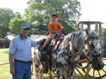 Bruce Arnold and his 3-year old grandson Max taking a ride on Chester.